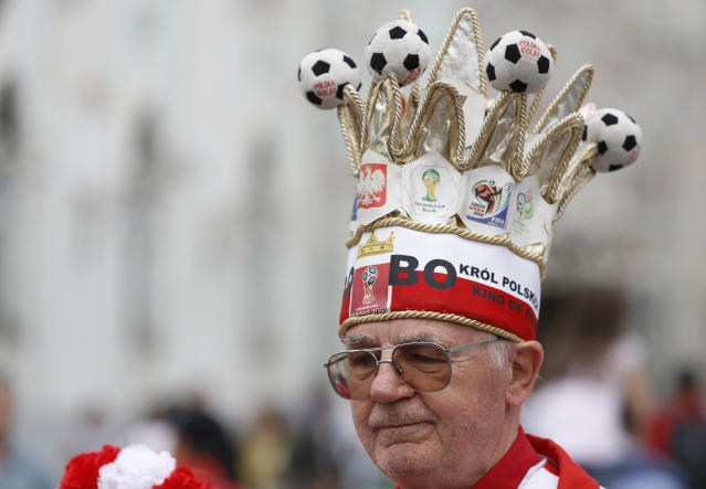 A soccer fan from Poland entertains supporters and tourists during the 2018 soccer World Cup in Moscow, Russia, Thursday, June 21, 2018. (AP Photo/Darko Bandic)