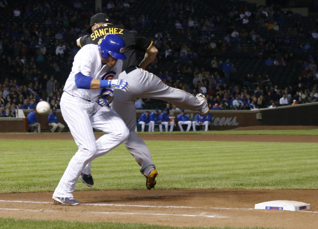 Chicago Cubs' Ryan Sweeney, left, is safe at first as Pittsburgh Pirates first baseman Gaby Sanchez is unable to catch a wide throw from third baseman Pedro Alvarez during the seventh inning of a baseball game Tuesday, Sept. 24, 2013, in Chicago. (AP Photo/Charles Rex Arbogast)