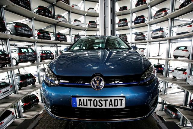 A Volkswagen Golf car is loaded in a delivery tower at the plant of German carmaker in Wolfsburg