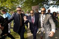 James Craig, a former Detroit Police Chief, is led from a news conference after announcing he is a Republican candidate for Governor of Michigan amongst protesters on Belle Isle in Detroit, Tuesday, Sept. 14, 2021. (AP Photo/Paul Sancya)