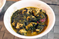 "<p>Palak chicken is an exceptionally delicious dish & easy to make. Take 1 tsp oil in a pan. Add cumin seeds, 2 cinnamon sticks, finely chopped onions, tomatoes and green chillies. Sauté for sometime and at this stage add some chopped spinach. Add salt and all the masalas of your choice. Stir for a few minutes and then add chicken. Cover it with some water and allow it to cook for 20-25 minutes. Garnish with some round onions and coriander leaves. ""Creative Commons Chicken Spinach Curry"" by Pelican is licensed under CC BY 2.0 </p>"