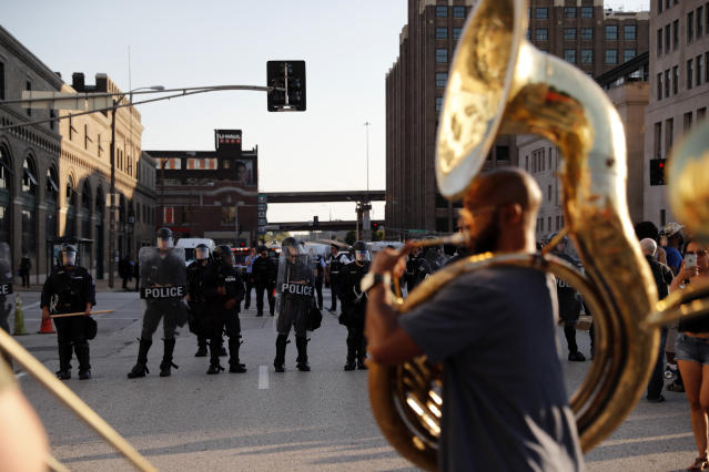 <p>Chris Tomlin plays a sousaphone as protesters gather, Friday, Sept. 15, 2017, in downtown St. Louis, after a judge found a white former St. Louis police officer, Jason Stockley, not guilty of first-degree murder in the death of a black man, Anthony Lamar Smith, who was fatally shot following a high-speed chase in 2011. (Photo: Jeff Roberson/AP) </p>