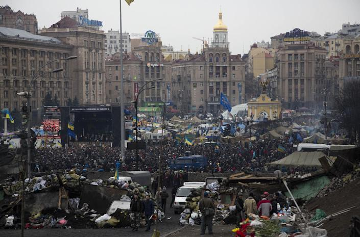 Protesters gather in the Independence square in central Kiev, Ukraine, Saturday, Feb. 22, 2014. Protesters in the Ukrainian capital claimed full control of the city Saturday following the signing of a Western-brokered peace deal aimed at ending the nation's three-month political crisis. The nation's embattled president, Viktor Yanukovych, reportedly had fled the capital for his support base in Ukraine's Russia-leaning east. (AP Photo/Darko Bandic)