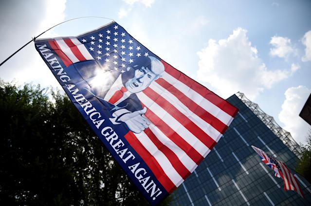<p>A Trump flag flies during a pro-Trump Rally in front of the U.S. Embassy in London on July 14, 2018. (Photo: Finbarr Webster/REX/Shutterstock) </p>