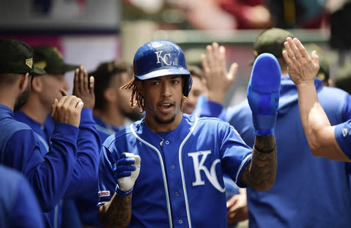 Kansas City Royals' Adalberto Mondesi is congratulated by teammates after scoring on a double by Kansas City Royals' Hunter Dozier during the third inning of a baseball game against the Los Angeles Angels Sunday, May 19, 2019, in Anaheim, Calif. (AP Photo/Mark J. Terrill)