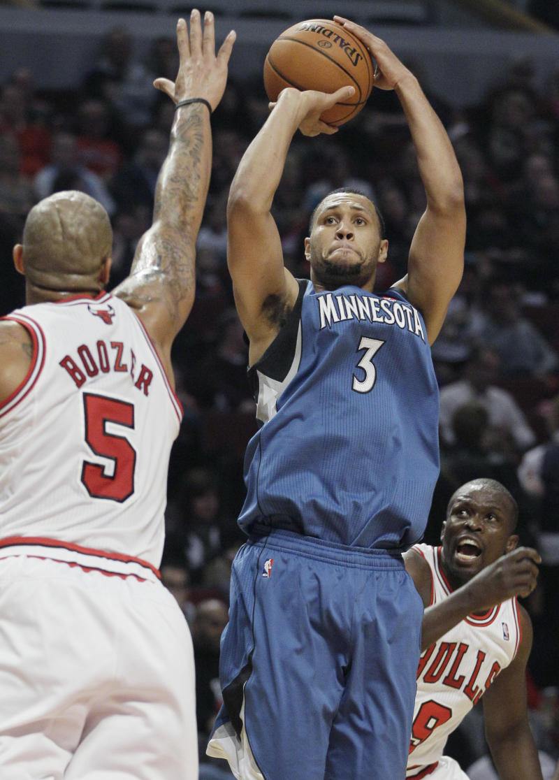 File-This Oct. 19, 2012 file photo shows Minnesota Timberwolves guard Brandon Roy (3) goes up for a shot against Chicago Bulls forward Carlos Boozer (5) during the first half of an NBA preseason basketball game in Chicago. To withstand the loss of Kevin Love and Ricky Rubio, the Timberwolves will need plenty of points from Roy. But coach Rick Adelman also needs to be wary of Roy's knees. Roy didn't play in the NBA last season and almost ended his career because of injuries.  (AP Photo/Nam Y. Huh, File)