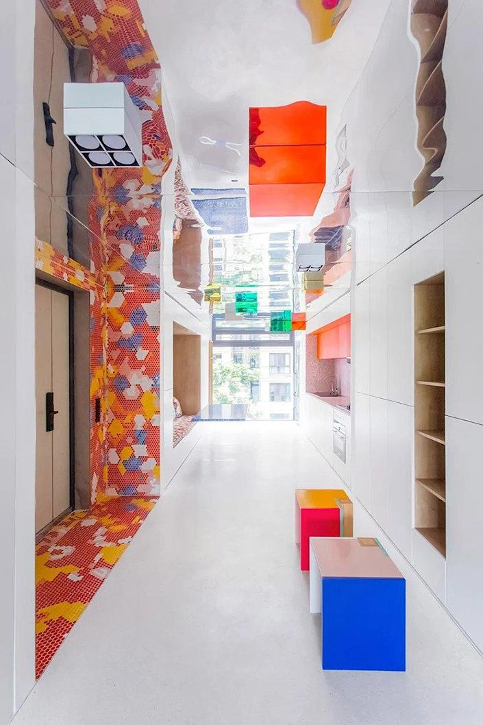 """The 000 Design-designed """"Live & Fun"""" apartment in Chongqing, China makes heavy use of colorful tile mosaics for a bold but relaxing effect."""