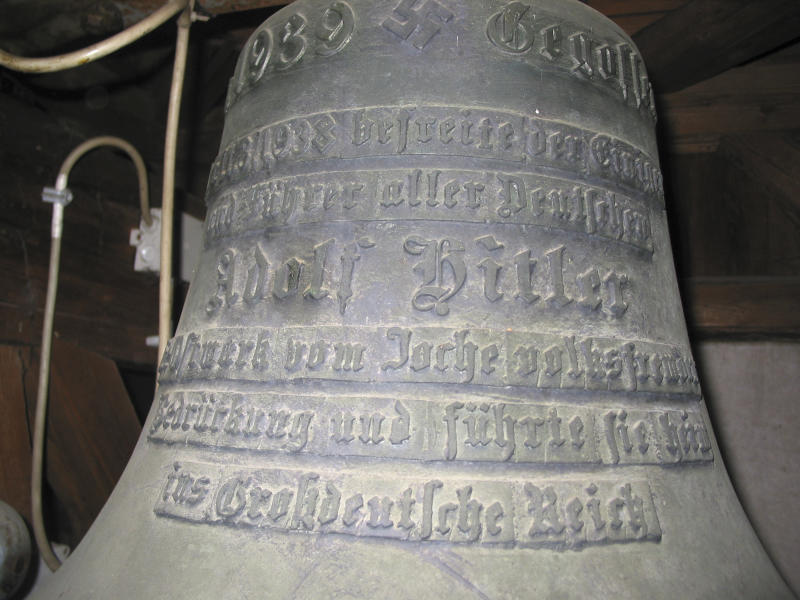 This Oct. 21, 2004 photo shows a bell with Adolf Hitler's name on it in the castle of Wolfpassing, Austria. Ensconced in the belfry of an ancient castle where it was mounted by fans of the Nazi dictator in 1939, the bell has tolled on for nearly 80 years. It survived the defeat of Hitler's Germany, a decade of post-war Soviet occupation that saw Red Army soldiers bivouacked in the castle and more recent efforts by Austrian government to acknowledge the country's complicity in crimes of that era and make amends. (AP Photo/Hannes Kammerstaetter)
