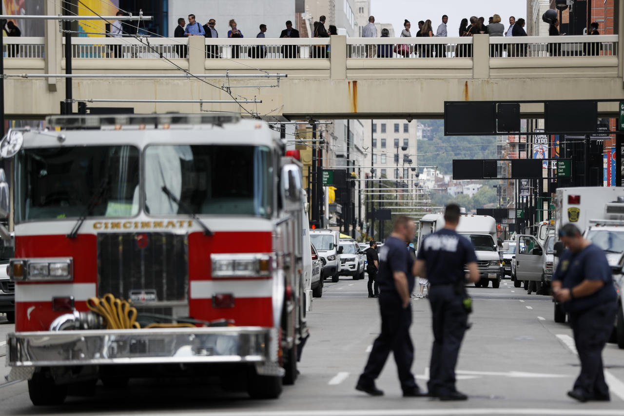 <p>Civilians are escorted from the Fifth Third Center as emergency personnel and police work the scene of shooting near Fountain Square, Thursday, Sept. 6, 2018, in downtown Cincinnati. (Photo: John Minchillo/AP) </p>