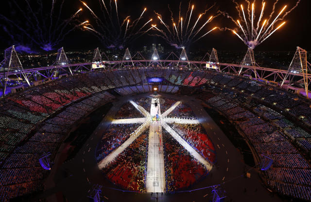 Fireworks explode during the Rio 2016 segment of the closing ceremony of the London 2012 Olympic Games at the Olympic Stadium August 12, 2012. REUTERS/Pawel Kopczynski (BRITAIN - Tags: SPORT OLYMPICS)