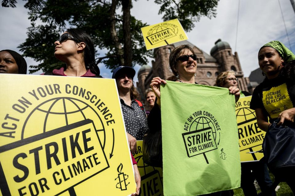 """<span class=""""caption"""">Amnesty International staff and volunteers gather at a climate change protest in Toronto in Sept. 2019. </span> <span class=""""attribution""""><span class=""""source"""">THE CANADIAN PRESS/Christopher Katsarov</span></span>"""