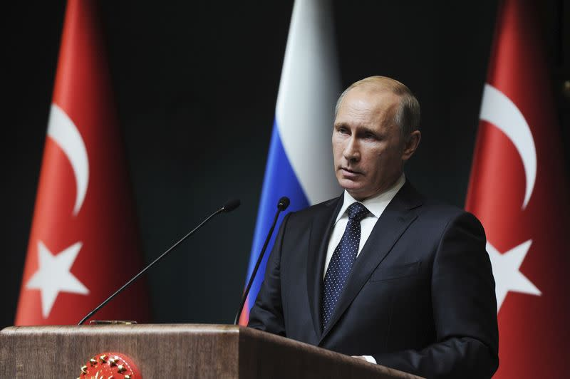 Russia's President Putin attends a news conference in Ankara
