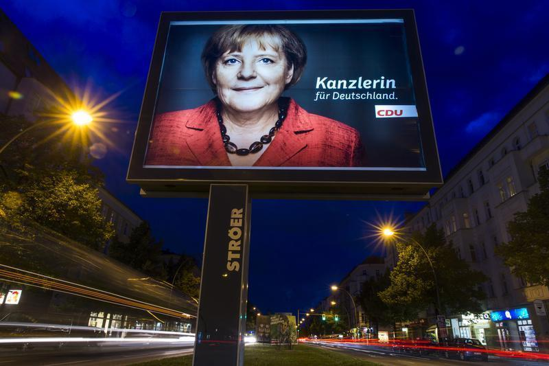 Election campaign poster of German Chancellor and CDU leader Merkel is seen in Berlin