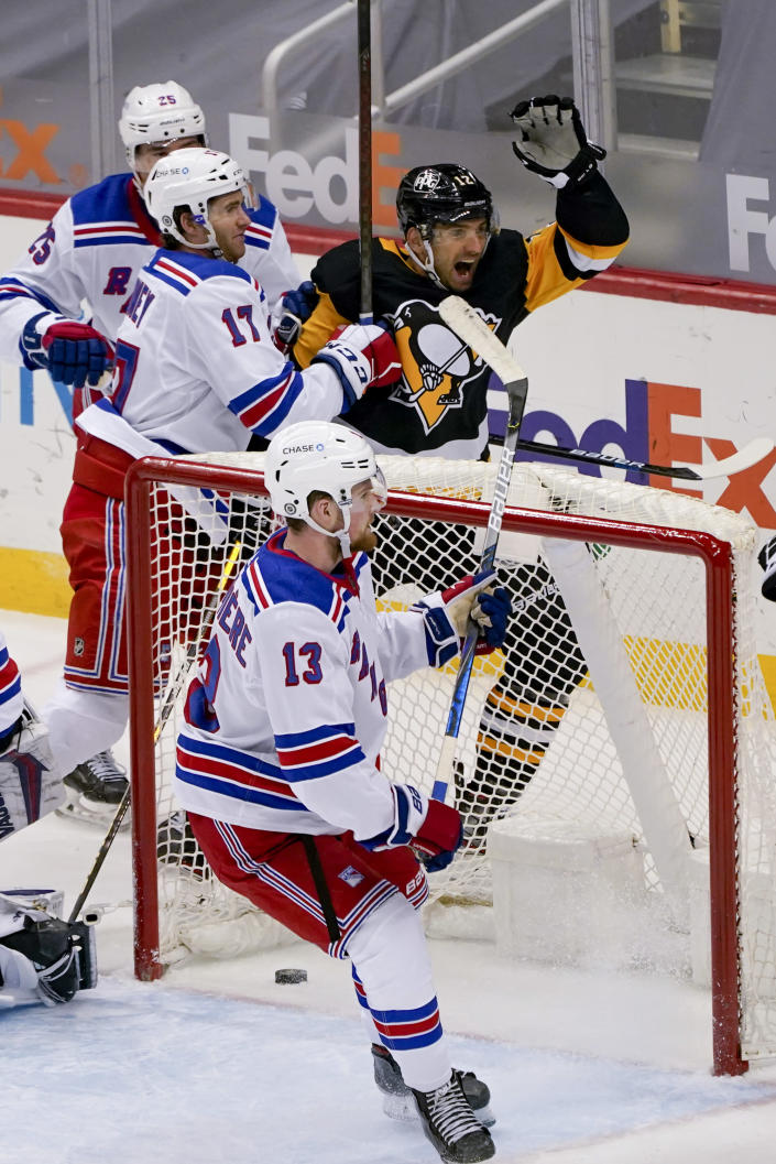 Pittsburgh Penguins' Zach Aston-Reese (12) celebrates after he scored against the New York Rangers during the third period of an NHL hockey game, Sunday, March 7, 2021, in Pittsburgh. (AP Photo/Keith Srakocic)