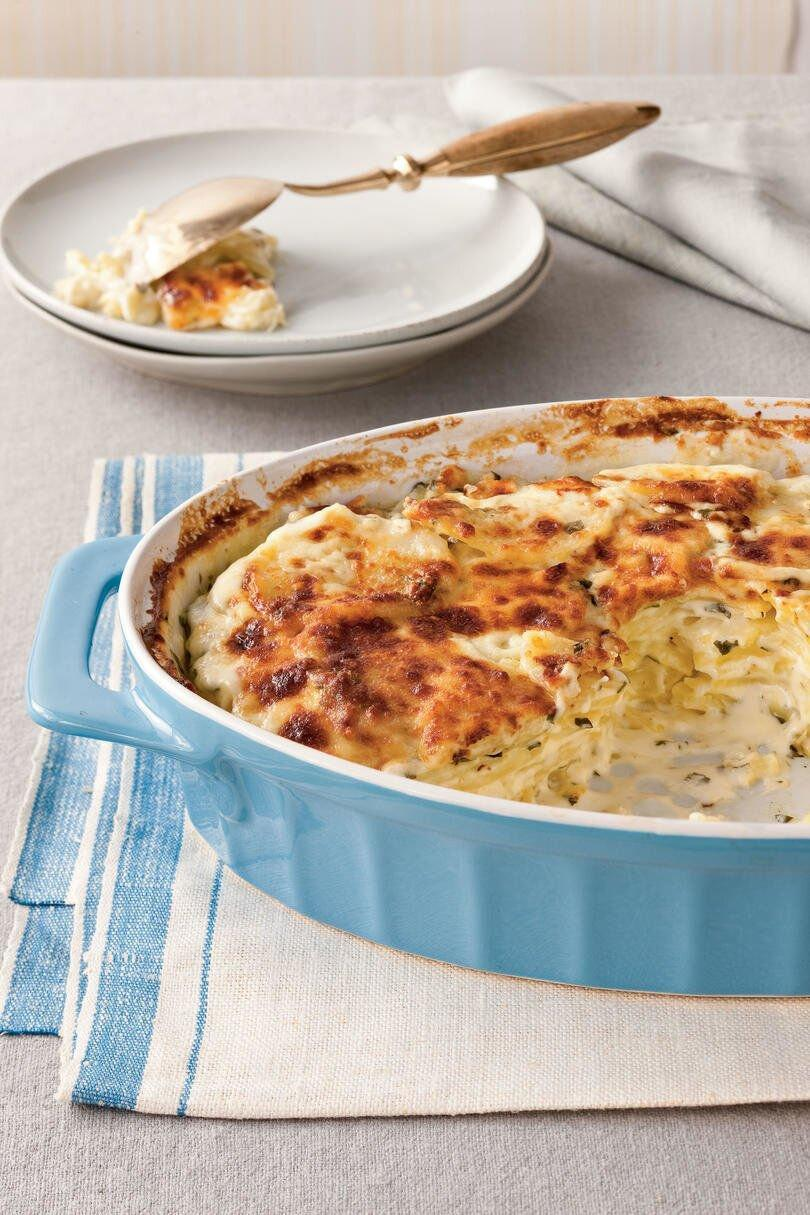 """<p><b>Recipe: <a href=""""https://www.southernliving.com/recipes/cheesy-scalloped-potatoes"""" rel=""""nofollow noopener"""" target=""""_blank"""" data-ylk=""""slk:Classic Parmesan Scalloped Potatoes"""" class=""""link rapid-noclick-resp"""">Classic Parmesan Scalloped Potatoes </a></b></p> <p>This scalloped potato recipe is easy to make but feels rather indulgent, thanks to nutty Parmesan cheese. </p>"""