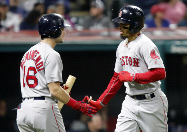 Boston Red Sox's Andrew Benintendi (16) greets Mookie Betts after his solo home run off of Cleveland Indians starting pitcher Adam Plutko in the fifth inning of a baseball game, Sunday, Sept. 23, 2018, in Cleveland. (AP Photo/Tom E. Puskar)