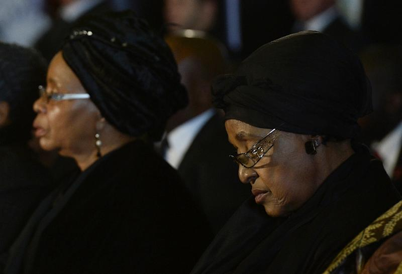Nelson Mandela's third wife, Graca Machel, left, and his second wife Winnie Mandela Madikizela attend a farewell service for the former South African president in 2013 (AFP Photo/STEPHANE DE SAKUTIN)