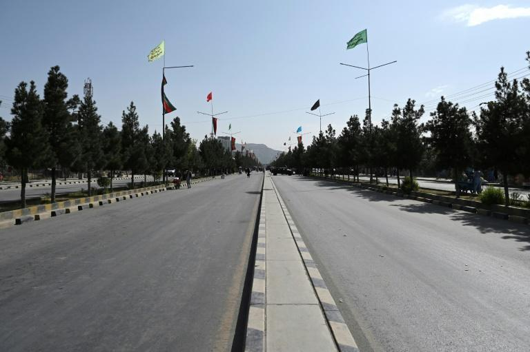 A Taliban-captured Humvee blocks a deserted road leading to the airport in Kabul (AFP/WAKIL KOHSAR)
