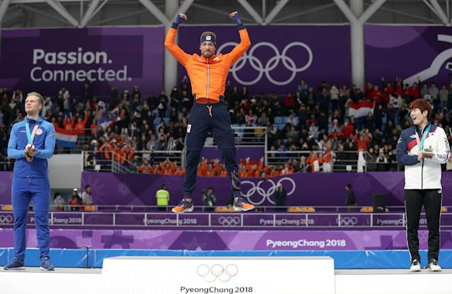 Speed Skating - Pyeongchang 2018 Winter Olympics - Men's 1000m competition finals - Gangneung Oval - Gangneung, South Korea - February 23, 2018 - Kjeld Nuis of the Netherlands celebrates a on the podium after winning a gold medal. REUTERS/Lucy Nicholson