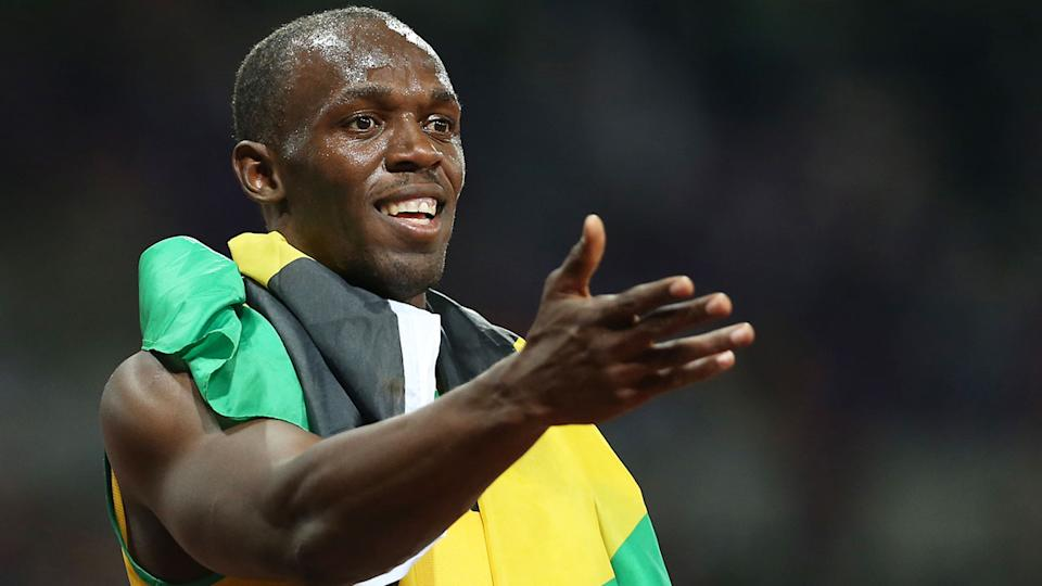 Pictured here, Usain Bolt gestures towards a supporter after a race. Pic: Getty