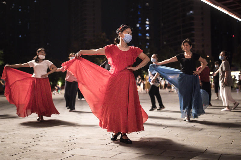 WUHAN, CHINA - JUNE 16: (CHINA OUT) Residents dance to exercise in Jiangtan park on June 16, 2020 in Wuhan, Hubei Province, China. As of June 13th, the response level of public health emergencies in Hubei Province has been reduced to level 3.Wuhan's health commission said that the city had no asymptomatic cases as of June 15, and there are no more close contacts under medical observation.(Photo by Getty Images)