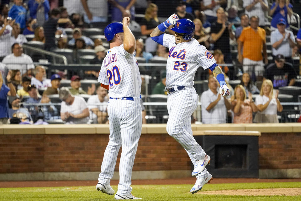 New York Mets' Javier Baez (23) celebrates with teammate Pete Alonso (20) after hitting a two-run home run in the sixth inning of the baseball game against the Cincinnati Reds, Saturday, July 31, 2021, in New York. (AP Photo/Mary Altaffer)