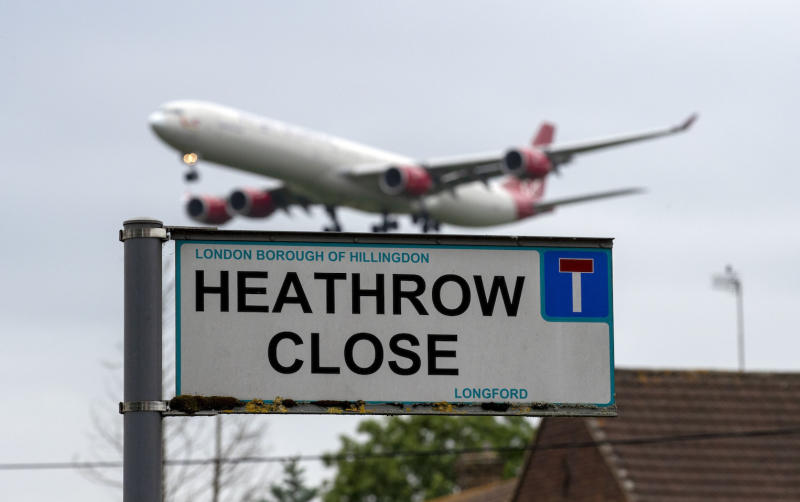 A plane landing at Heathrow Airport in west London viewed from the village of Longford (Picture: PA)