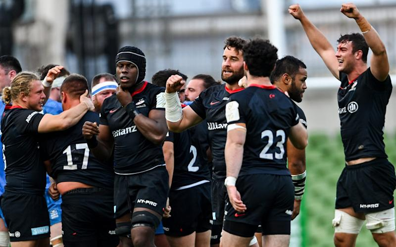 Saracens players celebrate at the final whistle of the Heineken Champions Cup Quarter-Final match between Leinster and Saracens - GETTY IMAGES