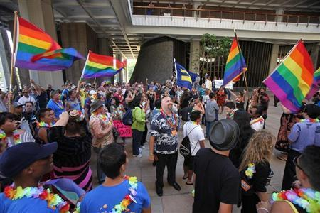 Supporters of same-sex marriage celebrate after the Hawaii State Senate approved a bill allowing same sex marriage to be legal in the state of Hawaii, in Honolulu