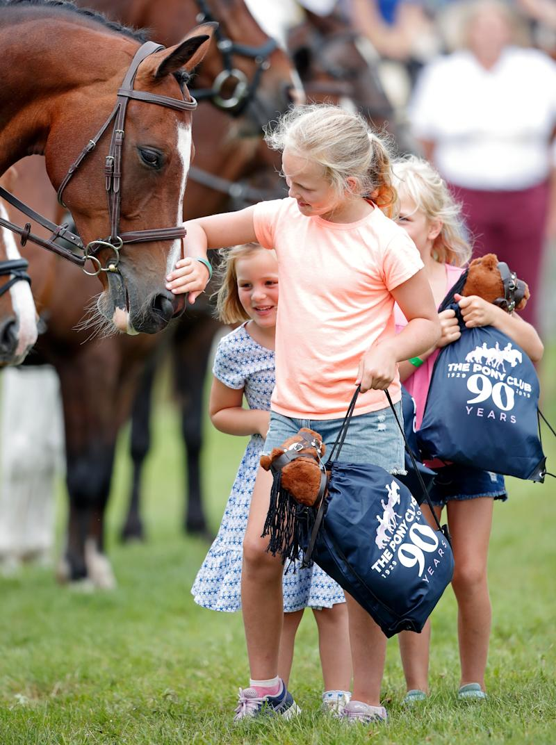 STROUD, UNITED KINGDOM - AUGUST 03: (EMBARGOED FOR PUBLICATION IN UK NEWSPAPERS UNTIL 24 HOURS AFTER CREATE DATE AND TIME) Mia Tindall, Savannah Phillips and Isla Phillips meet horses of the Pony Club as they attend day 2 of the 2019 Festival of British Eventing at Gatcombe Park on August 3, 2019 in Stroud, England. (Photo by Max Mumby/Indigo/Getty Images)