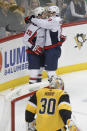 Washington Capitals' Nic Dowd, left, celebrates with Garnet Hathaway after scoring on Pittsburgh Penguins goaltender Matt Murray (30) during the first period of an NHL hockey game, Saturday, March 7, 2020, in Pittsburgh. (AP Photo/Keith Srakocic)