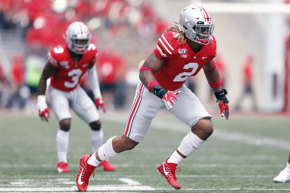 FILE - In this Aug. 31, 2019, file photo, Ohio State defensive end Chase Young, right, works against Florida Atlantic during an NCAA football game, in Columbus, Ohio. Ohio State says defensive end Chase Young won't play Saturday against Maryland due to possible NCAA violation in 2018.(AP Photo/Paul Vernon, File)