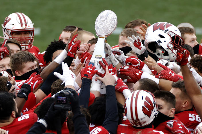 The Wisconsin Badgers celebrate their victory over the Wake Forest Demon Deacons after winning the Duke's Mayo Bowl at Bank of America Stadium on December 30, 2020 in Charlotte, North Carolina. (Photo by Jared C. Tilton/Getty Images)