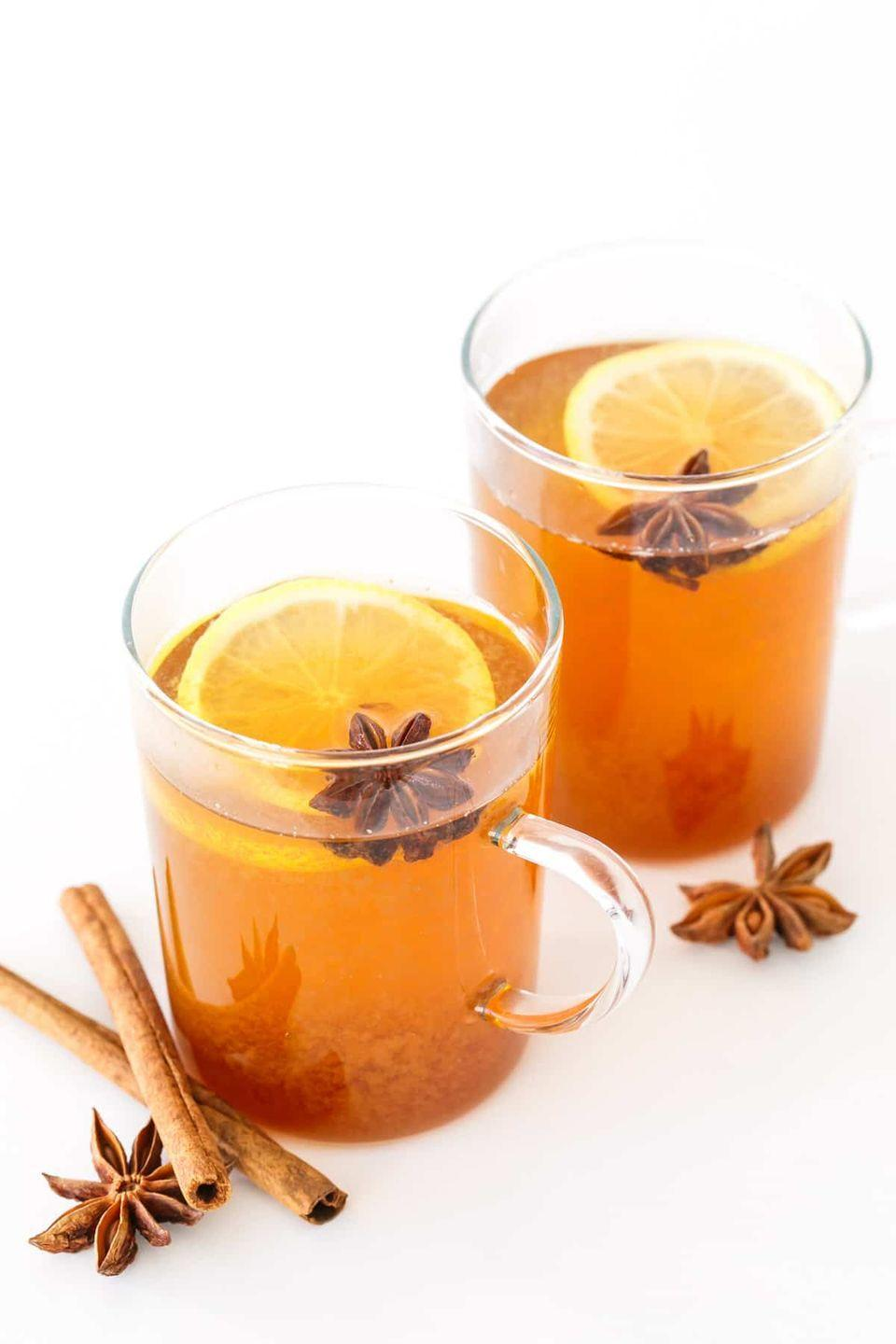 """<p>This warm drink is like comfort in a glass, thanks to a blend of chamomile tea, honey, lemon, and spices. (And, oh yeah, Bourbon helps, too.) </p><p><a class=""""link rapid-noclick-resp"""" href=""""https://www.loveandoliveoil.com/2016/12/spiced-chamomile-hot-toddy.html"""" rel=""""nofollow noopener"""" target=""""_blank"""" data-ylk=""""slk:GET THE RECIPE"""">GET THE RECIPE</a></p>"""