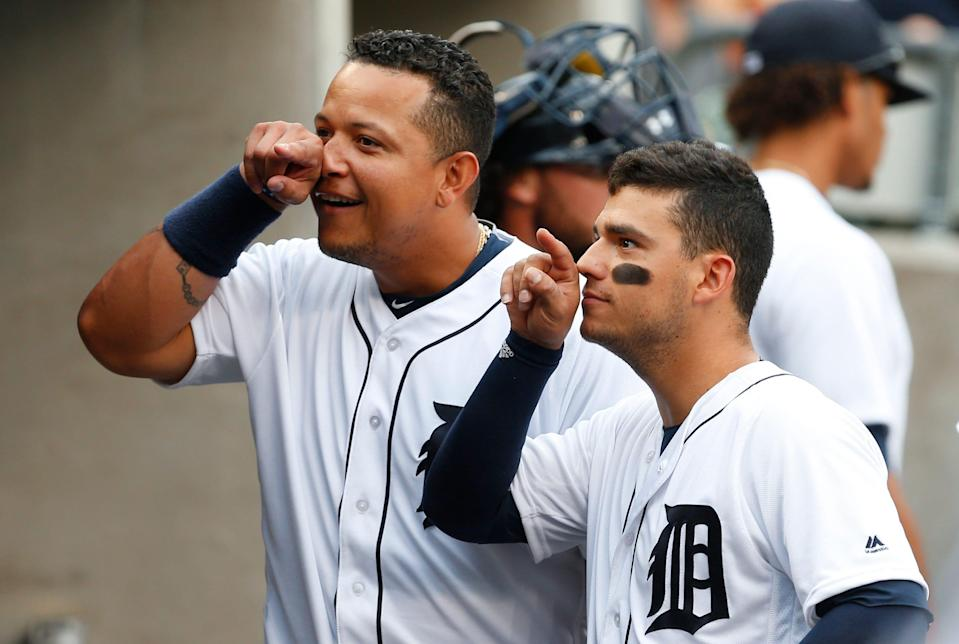 Detroit Tigers' Miguel Cabrera, left, and Jose Iglesias joke with a teammate before a baseball game against the Seattle Mariners in Detroit, Wednesday, June 22, 2016. (AP Photo/Paul Sancya)
