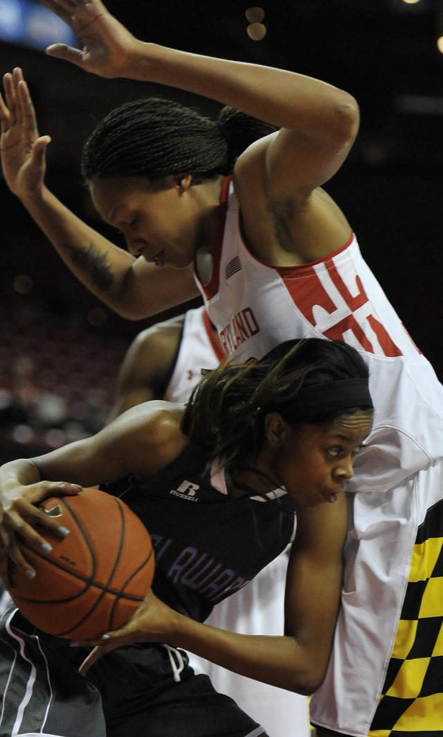 Delaware State's Raven Bankston, bottom, comes away with a rebound as Maryland's Alicia DeVaughn, top, defends in the first half of an NCAA college basketball game on Saturday, Dec. 14, 2013, in College Park, Md. (AP Photo/Gail Burton)