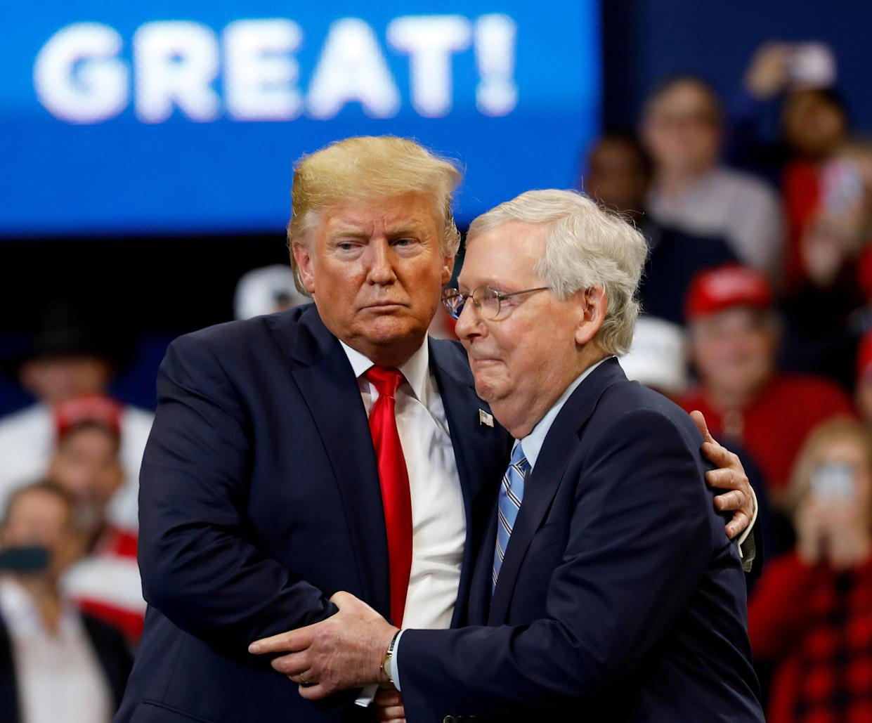Senator Mitch McConnell (R-KY) hugs U.S. President Donald Trump at a campaign rally at the Rupp Arena in Lexington, Kentucky, U.S., November 4, 2019. REUTERS/Yuri Gripas     TPX IMAGES OF THE DAY