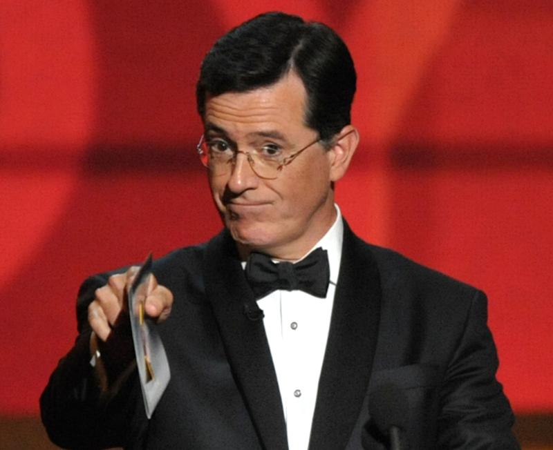 FILE - In this Sept. 23, 2012 file photo, Stephen Colbert presents an award onstage at the 64th Primetime Emmy Awards at the Nokia Theatre in Los Angeles. South Carolina Gov. Nikki Haley appears to have closed the door on appointing Colbert to the U.S. Senate, all because he didn't know the state drink was milk. (Photo by John Shearer/Invision/AP, File)