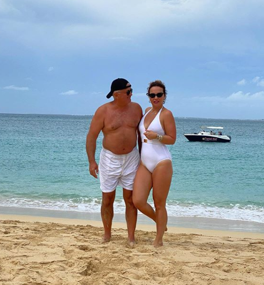 Vera Sahatçiu Ora with her husband, Besnik 'Nick' Sahatçiu Ora, on a beach in St. Barts.