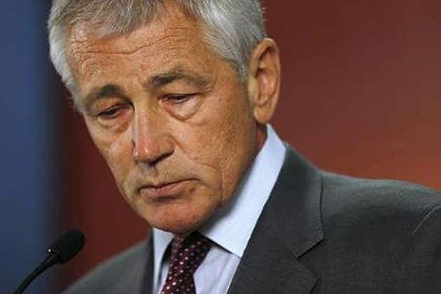"""U.S. Defense Secretary Chuck Hagel says """"the Department of Defense intends to make the same benefits available to all military spouses—regardless of sexual orientation—as soon as possible."""" (Jason Reed/Reuters)"""