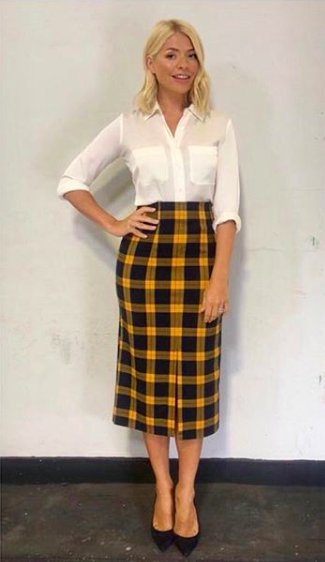 <p>In case you didn't already notice, checks are everywhere RN. Holly demonstrated how to tackle the trend in a Topshop skirt on 4 September (which has since sold out). She finished the look with a white shirt by Winser London and LK Bennett shoes. <em>[Photo: Instagram]</em> </p>