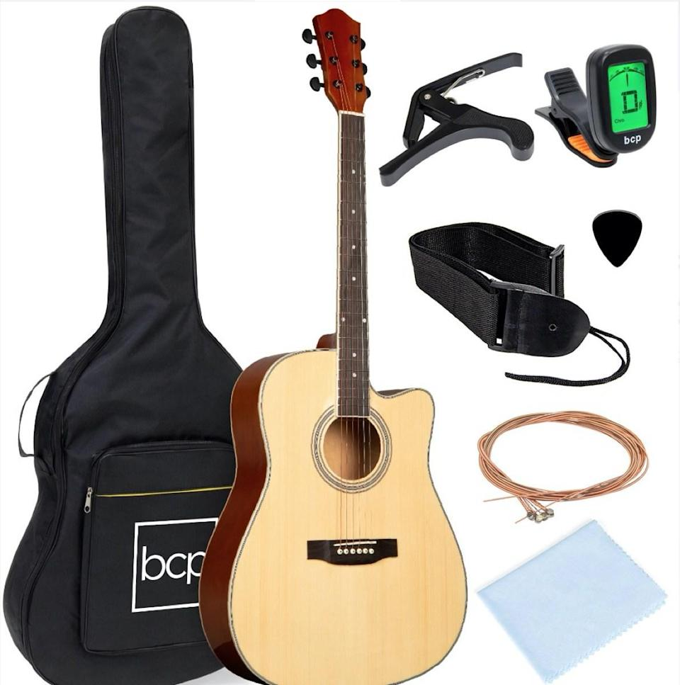 guitar kit with capo, tuner, strings, and case
