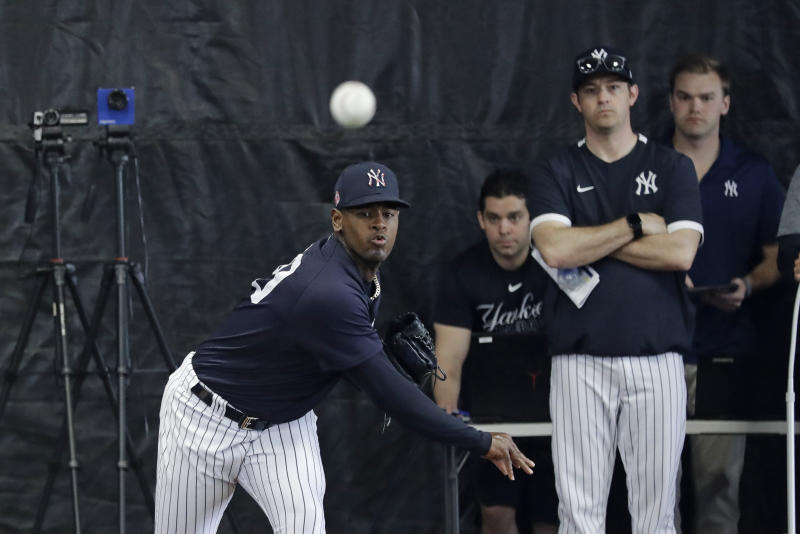 New York Yankees' Luis Severino delivers a pitch in the bullpenn during a spring training baseball workout Thursday, Feb. 13, 2020, in Tampa, Fla. (AP Photo/Frank Franklin II)