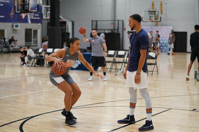 Azzi Fudd works on a drill with Golden State Warriors guard Stephen Curry. (Photo credit: Cassy Athena for Under Armour)