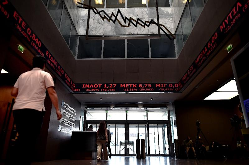 Greece's stock exchange reopened August 3, but saw record falls by the end of the trading day (AFP Photo/Aris Messinis)