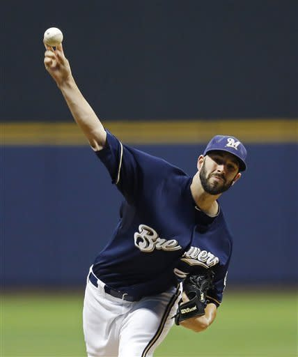 Milwaukee Brewers' Mike Fiers pitches to a New York Mets batter during the first inning of a baseball game on Friday, Sept. 14, 2012, in Milwaukee. (AP Photo/Tom Lynn)