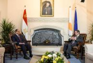 Cyprus' President Nicos Anastasiades and Egypt's President Abdel Fattah al-Sisi talk during a meeting at a trilateral summit between Greece, Cyprus and Egypt, at the Presidential Palace in Nicosia