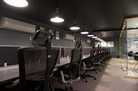 The Black Zone with ergonomic furniture & clamped lighting on the ceiling.