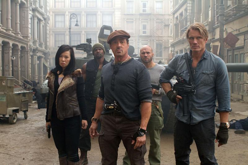 """This film image released by Lionsgate shows, from left, Yu Nan, Terry Crews, Sylvester Stallone, Randy Couture and Dolph Lundgren in a scene from """"The Expendables 2."""" The cast of """"The Expendables 2"""" say they're giving co-star and writer Sylvester Stallone space after the death of his son, Sage Moonblood Stallone, on July 13, 2012. Stallone has not made any public appearances since the death.  """"Expendables 2"""" opens Aug. 17.  (AP Photo/Lionsgate-Millennium Films, Frank Masi)"""