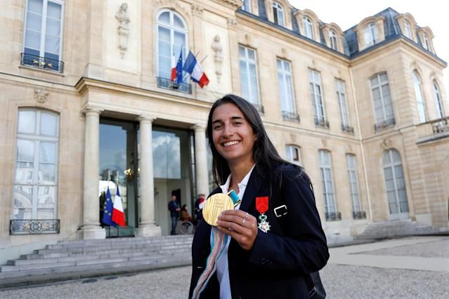 Perrine Laffont, French Olympic gold medalist in the moguls event in freestyle skiing during the Pyeongchang 2018 Winter Olympic Games, poses after being awarded Chevalier of the Legion of Honour (Legion d'honneur) during an award ceremony gathering French athletes that competed in the 2018 Pyeongchang Olympics winter Games, at the Elysee Palace in Paris, France, April 13, 2018. Reuters/Charles Platiau